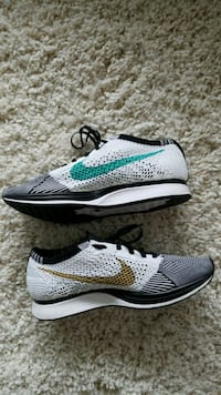 pair of gray-and-green Nike running shoes