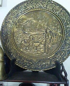 round gray with sailing boat relief decorative plate
