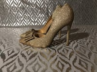 pair of gold glittered pointed toe. Size 8.5 Manassas, 20109