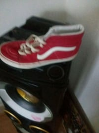 pair of red-and-white Nike sneakers Riverdale, 30296
