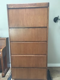 Solid oak filing cabinet, excellent condition, holds legal or regular size files