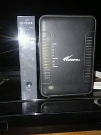 black Westell and Netgear Wi-Fi routers