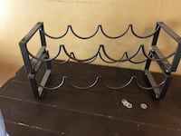 Brown metal bottle rack..stackable