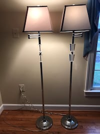 Two free standing floor lights in chrome