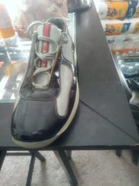 pair of black leather loafers 64 km