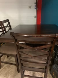 Bar style dining table with 4 chairs