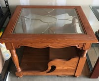 brown wooden framed glass top coffee table Fort Worth, 76179