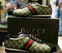 brown-and-black Gucci low-top sneakers Faridabad, 121001