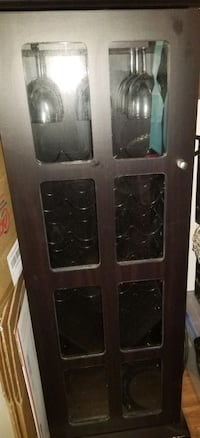 Wine cabinet with glass rack