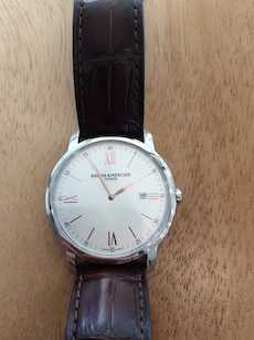 Baume and mercier. Comes with certificate of authenticity