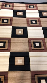 Three brown-and-black area rugs Allentown, 18109