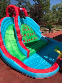Inflatable water slide. Only two months old. New $450