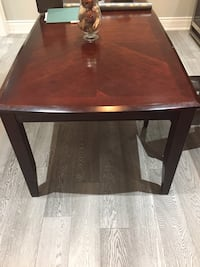 Rectangular brown dinning table with middle extension and two chairs