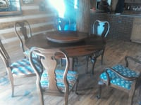 brown wooden table with chairs 376 mi