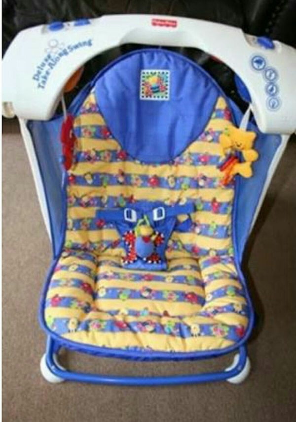 fisher price deluxe take along swing.  8e21a9a9-6759-4023-9f3d-6d056d637d24