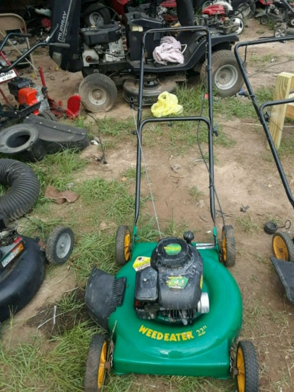 green and black Weed Eater push mower