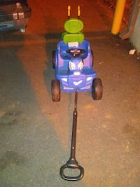 toddler's blue and green ride-on toy