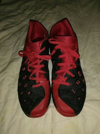 pair of red-and-black basketball shoes Regina, S4P 1M6