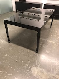 Black glass top dining table from Inform Vancouver, V6A 1R3