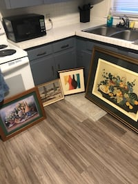 four black wooden framed paintings Springfield, 45505