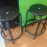 pair of black and brown wooden bar stools Rochester, 14613