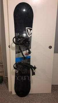 Black and gray snowboard with barely used bindings St Albert, T8N 1W3