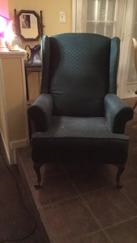 green winged back classic chair