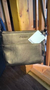 Brand new goldfish brown authentic Calvin Klein puse Windsor, N8W 2E4