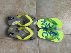 two pairs of assorted color rubber flipflops
