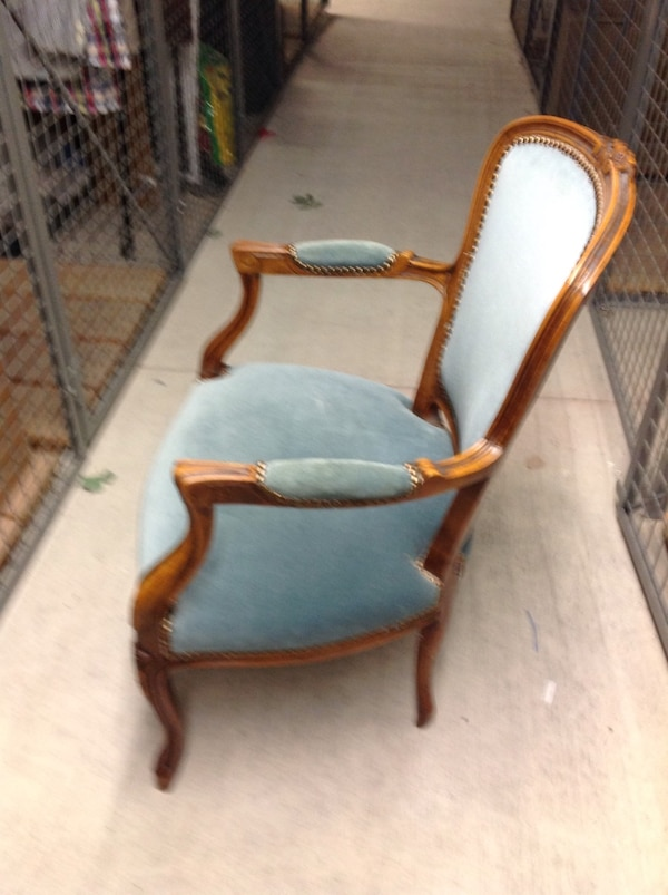 brown wooden frame gray padded armchair 5a7a8f3a-524e-4f46-8f04-74bfec3c869c