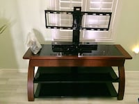 """TV Stand 50"""" wide by 15"""" deep. Solid wood with glass shelves. Henderson, 89012"""