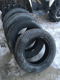 Brand new with less than 25 KM on them. Used them on my commuter car but plans change due to having a family on the way. Excellent tires! For a good price. 215/60 R16