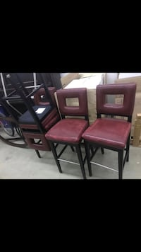 Two red leather padded chairs Edmonton, T6C 2B9