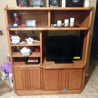 brown wooden TV hutch with flat screen television Denham Springs, 70726