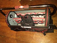 metal framed red and black tool caddy