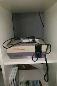Nintendo NES original system. Comes with remote and mario/duck hunt