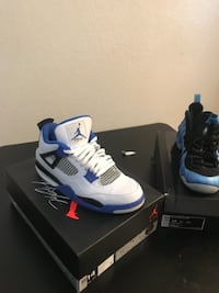 pair of white-and-blue Air Jordan shoes LANCASTER