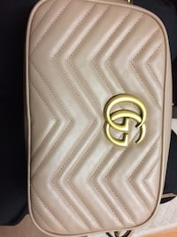 white and gold-colored leather wristlet Toronto, M6B 1A9