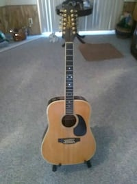 brown and black acoustic guitar New Port Richey, 34654