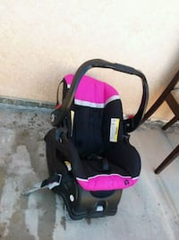 baby's black and pink car seat carrier Imperial