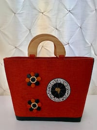 """Handmade purse from KENYA, AFRICA! Lovely orange straw purse with wooden handles and black leather trim. Zipper closure. Inside zipper pocket. LIKE NEW! Paid $150 for it at a craft fair. Measures 17"""" tall x 12"""" wide and is 6"""" deep at base Potomac, 20854"""