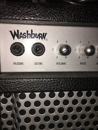 Black and gray washburh electric guitar amplifier