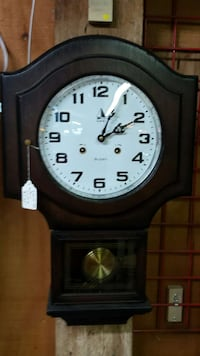 black wooden wall mounted pendulum clock Saint Catharines, L2R 6P9