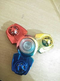 red, yellow and blue tri-spinner fidget toy Delhi, 110092