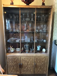 Brown wooden framed glass display cabinet without contents New York, 11377