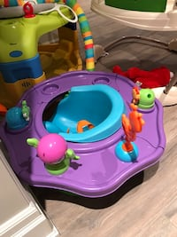 baby's pink and blue activity saucer