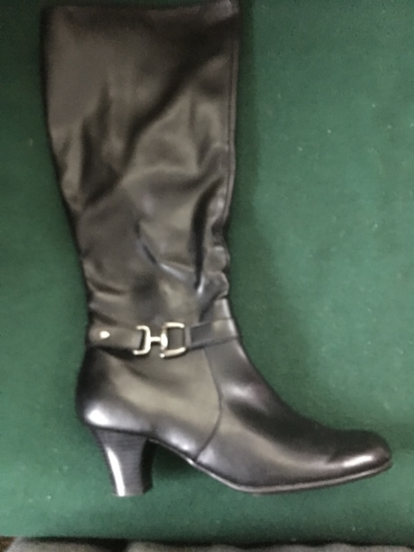 Pair of black leather knee-high boots