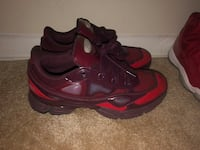 pair of red-and-black Nike basketball shoes Washington, 20011