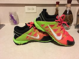 Pair of green-pink-black-and-white Nike running shoes