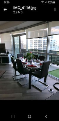 HIGH END DINING TABLE WITH SOLID CHROME & TEMPERED GLASS.  Toronto, M8V 0A3